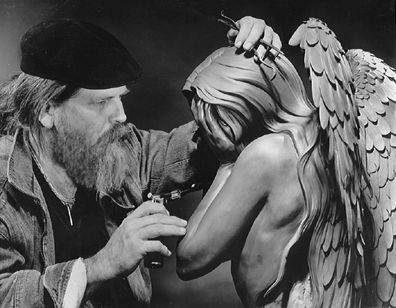 John sculpting Poreia